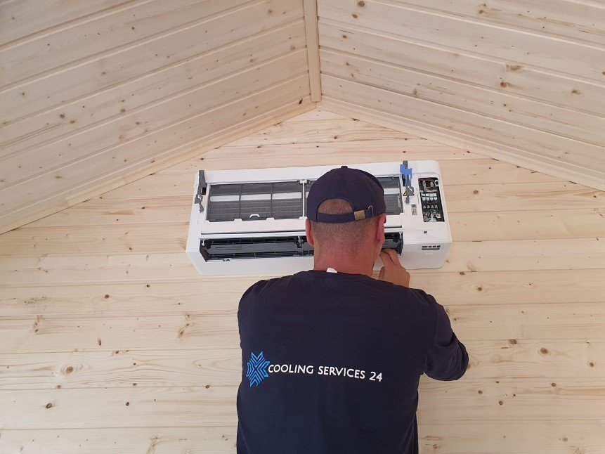 Coolingservices24 installing an air con unit in Surrey
