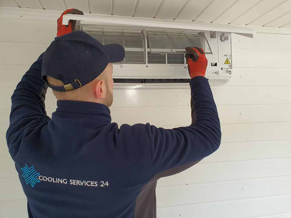 Coolingservices24 installing air conditioning unit in London for a client